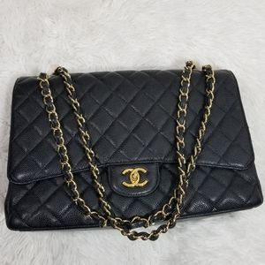 Chanel Maxi flap in black quilted caviar leather